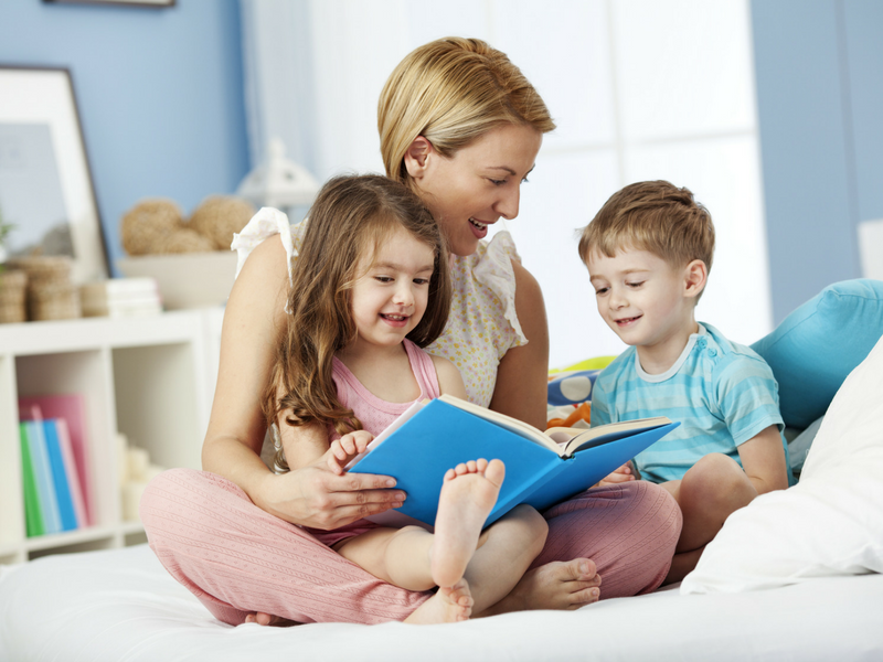 Mom-reading-to-her-homeschool-children